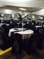 Black and white feather centrepieces and black Chair covers